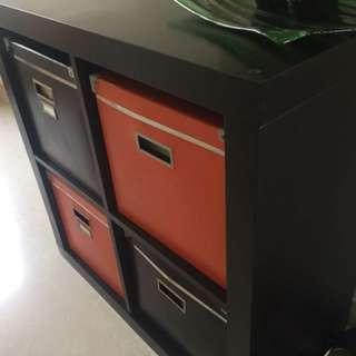Ikea shelf unit with boxes