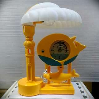 BN Swinging Yellow Dolphin Table Lamp cum Clock, in Happy😀Yellow!