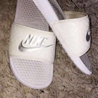 White Nike slides
