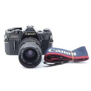 Canon AE-1 Black w Lens (35mm vintage film SLR Camera)