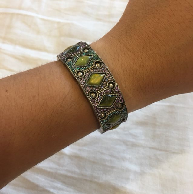 Metal bracelet on stretchy string