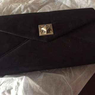 Suede clutch bag with chain sling