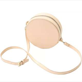 Nude round leather bag