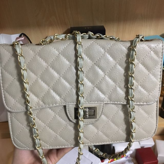 Beige side bag clutch