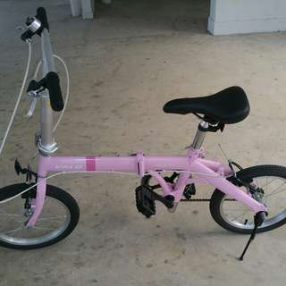 Pink folding bicycle