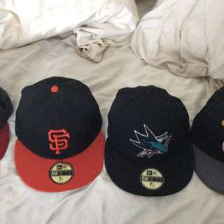 4 hats. Detroit Tigers, San Fran Giants, San Jose Sharks, Boston Bruins