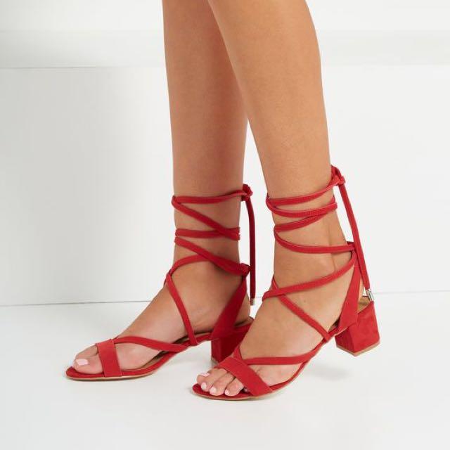 Red tie-up heels