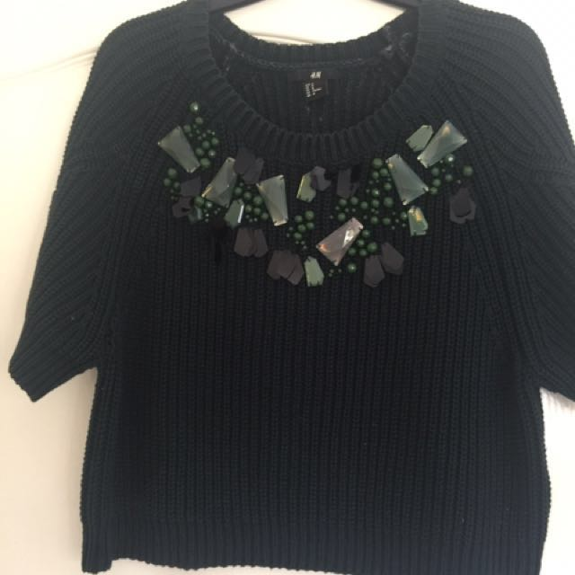 Emerald green cropped jumper with t-shirt sleeves. Beautiful beading on the neckline. Getting dry cleaned today so will be like new when you buy!