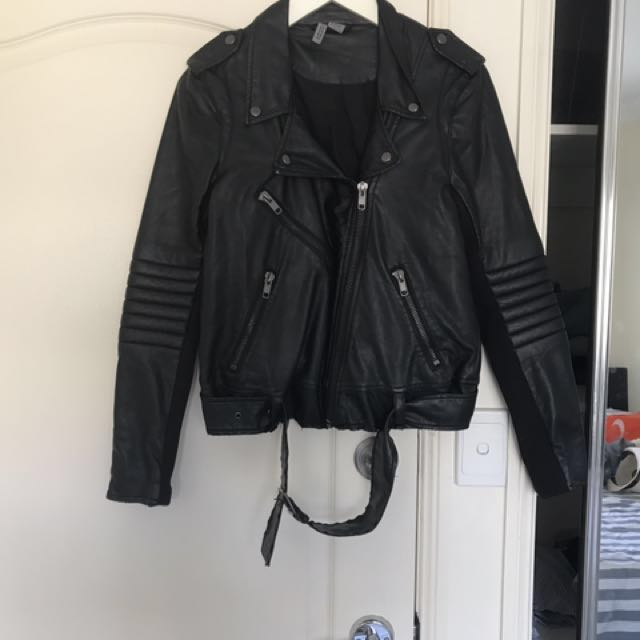 Faux leather biker jacket. Fabric on the inside of each sleeve (see photo). Size 10. Worn a few times.