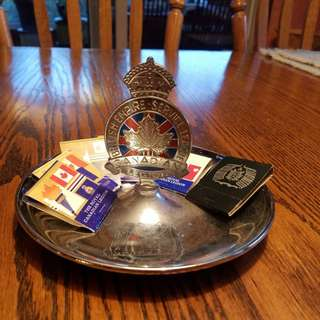 Royal Canadian Legion ashtray/coin dish with vintage matchbooks