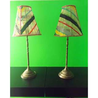 Two used metal lamp shade candle holders can be sold separately. The lamp shades are material with different colour sequence on them! Nothing is wrong with them (mint condition)