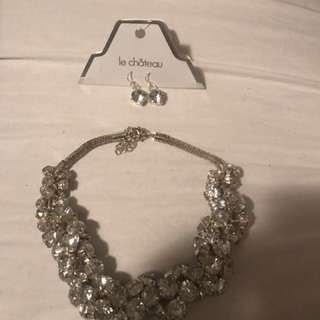 Silver diamond embellished necklace and pair of dangling earrings