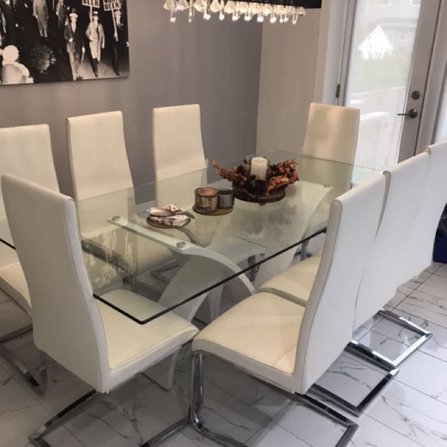 Glass table and 8 leather like chairs
