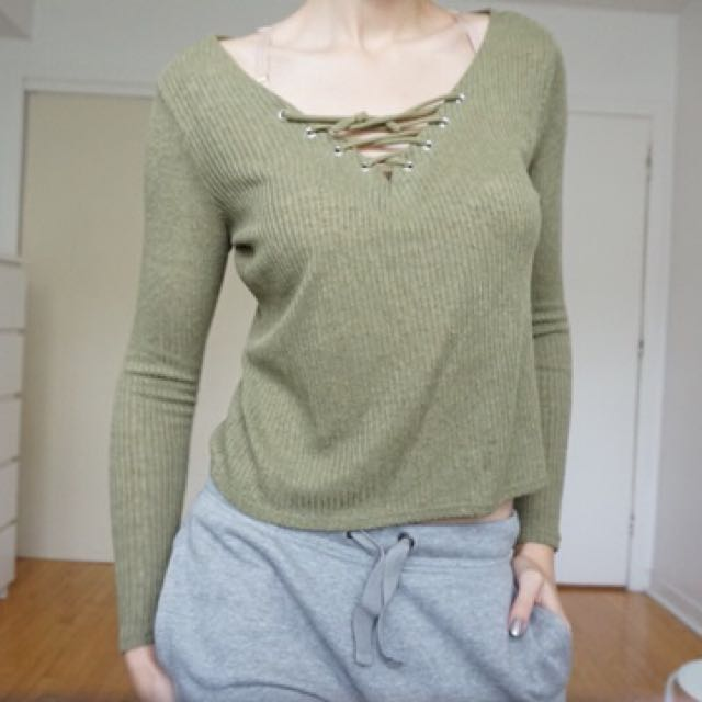 Long sleeve top with a lace up neck