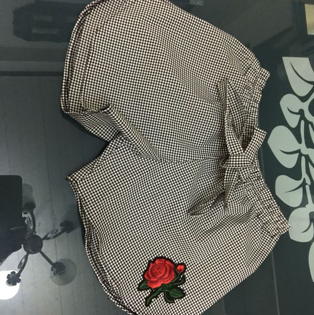 Short with rose patch