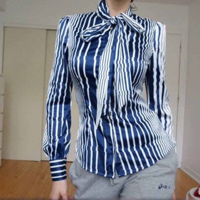 Striped satin shirt with a tie