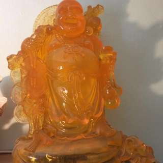 Smiling Buddha In Bright Orange Color