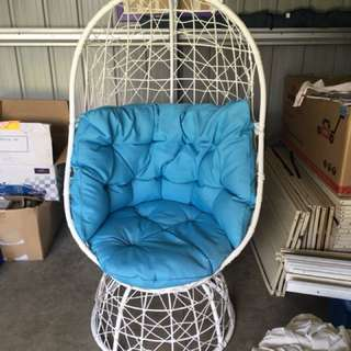 Blue and white spinning chair
