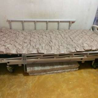 Motorised hospital bed with air mattress. Accessory- air pump. Single size