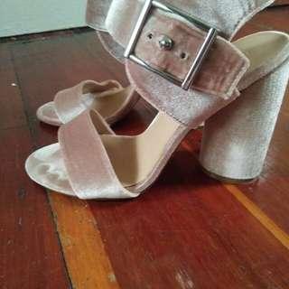 Blush velvet heels.