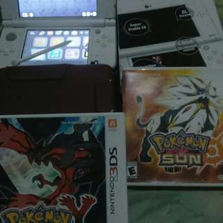 New nintendo 3ds xl with box,hard and jelly case, and 2 oridinal games, pokemon y and pokemon sun