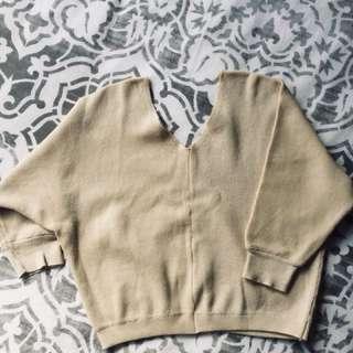 Beige color knit top