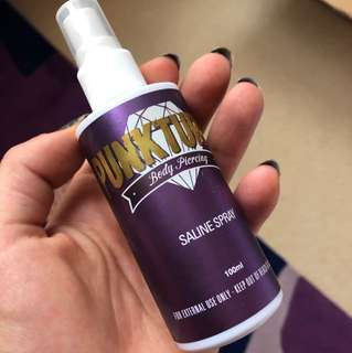 Saline piercing spray