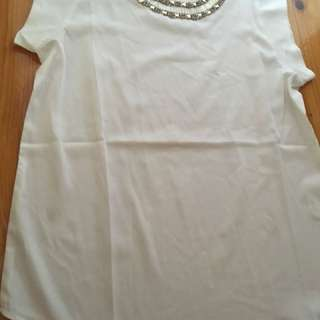 White top with detail on collar
