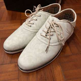 white patterned shoes