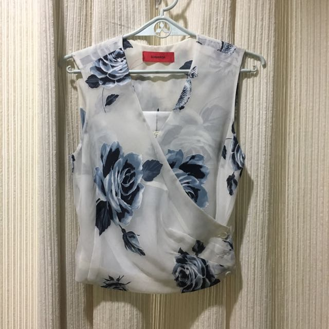 Blue and white wrap blouse