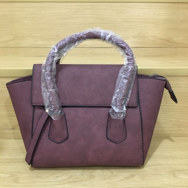 Brand new handbag with long sling strap