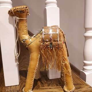 Hand stitched leather camel figure