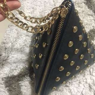 Navy blue bag with gold rivet