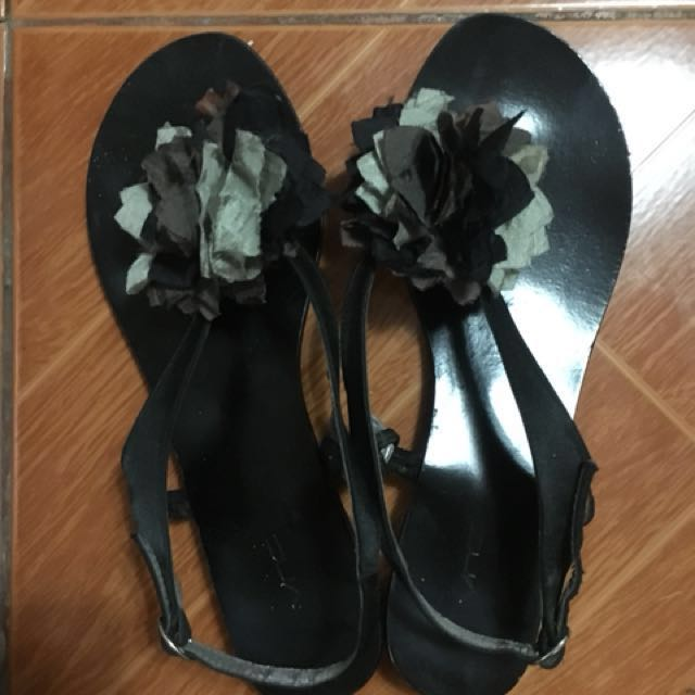Black VNC sandals with bloom accent.