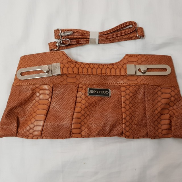 Brand new never used brown womens clutch with long strap