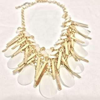 Chunky white and gold tone statement necklace