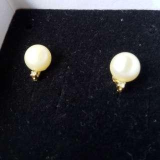 Delicate pearl stud earrings