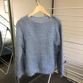 Hand knitted blue woollen jumper