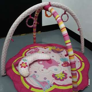 Play mat with toys and pillow