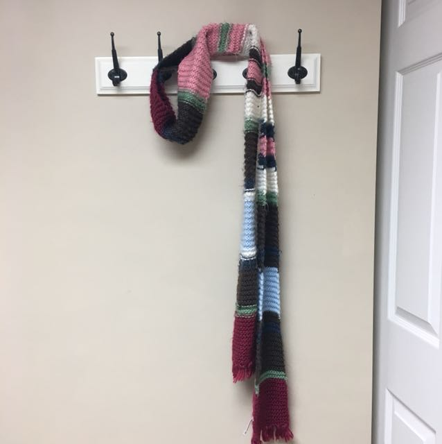 Long multicoloured knitted scarf