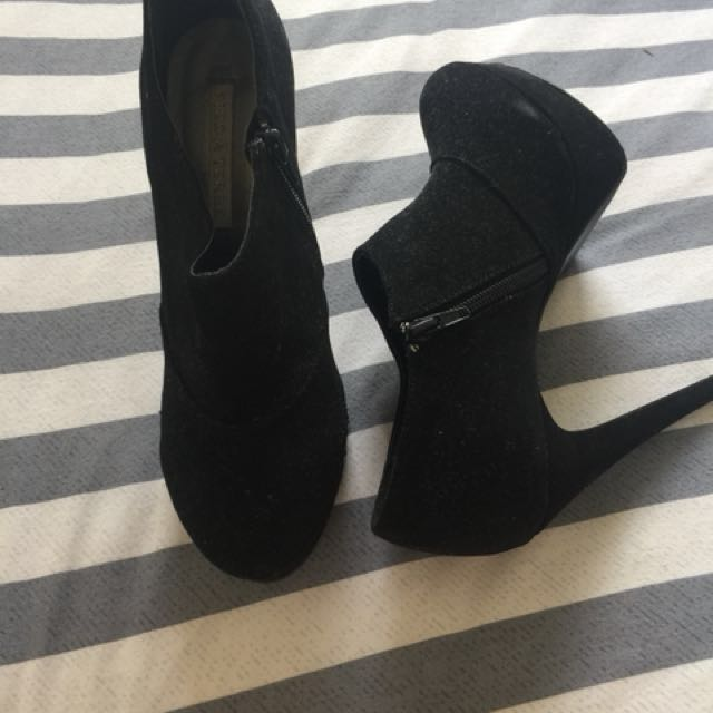 Black shoe boots. Size 8. A little dusty as they have been in storage. Worn a couple of times. A few scuff marks. See photos. Soles barely worn. Please ask for more photos if needed.