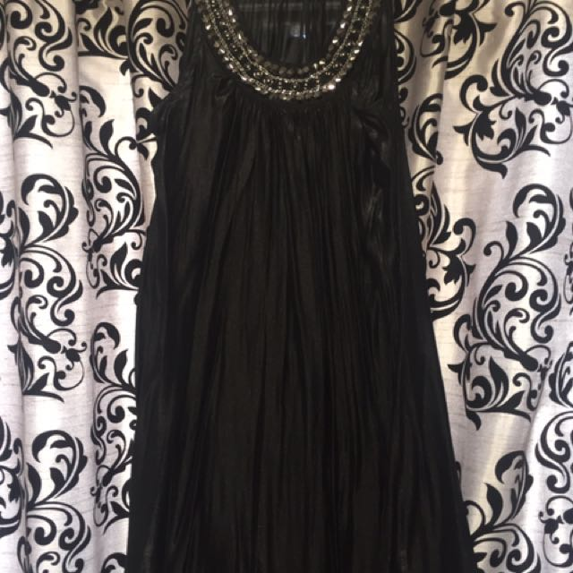 Black light material dress with sequinned neckline