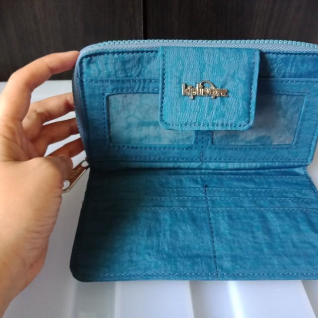 kipling long wallet with metal logo