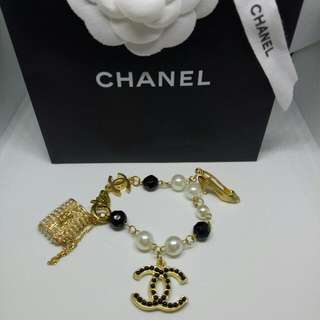 Chanel Inspired Bracelet Gold Tone With CC, Heel Shoe,  Handbag Charms And White And Black Beading Jewellery