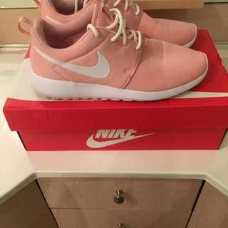 Size 7 pink Nike Roshe Ones