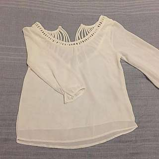 Long sleeved off-white chiffon blouse with sheer sleeves and patterned back