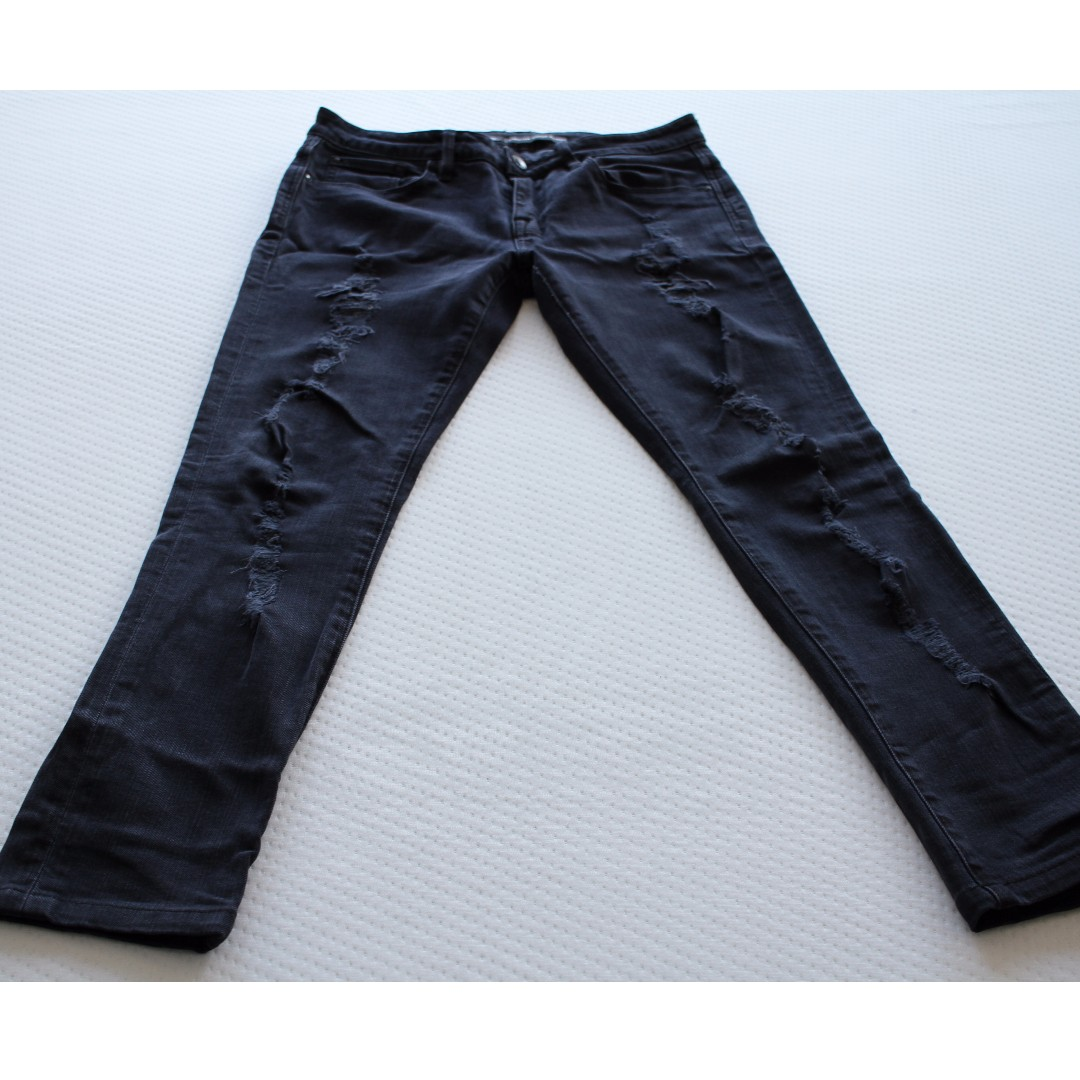 Lee Rider's - Bumster Super Skinny Dark Blue Jeans with rips in the front - Size 12