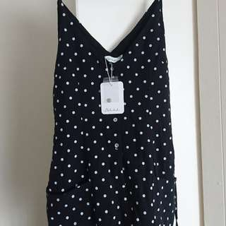 Black and white polka dot playsuit