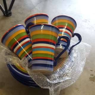 4 cups and 4 bowls, very colourful