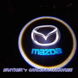 Mazda Door Welcome Light Shadow Logo Light